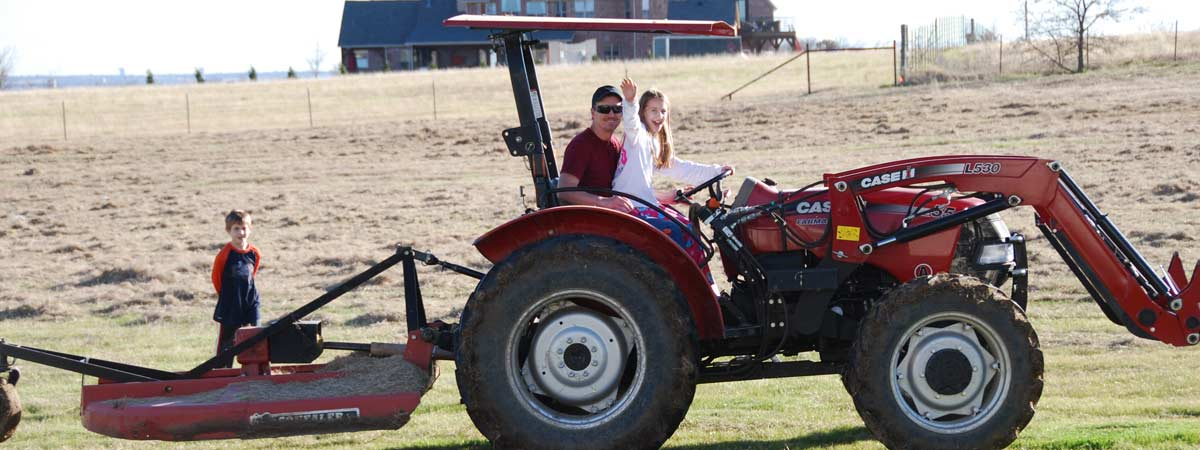 father daughter on tractor